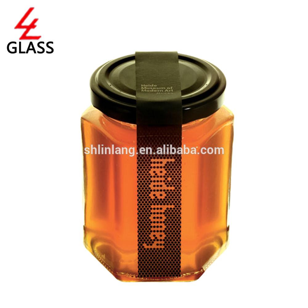 Šanhajas linlang sešstūra stikla medus burka ar melnu vāku pudelēs